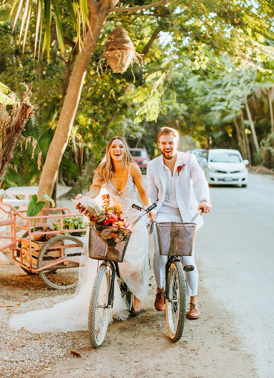 couple going for a tropical bike ride at their destination wedding location