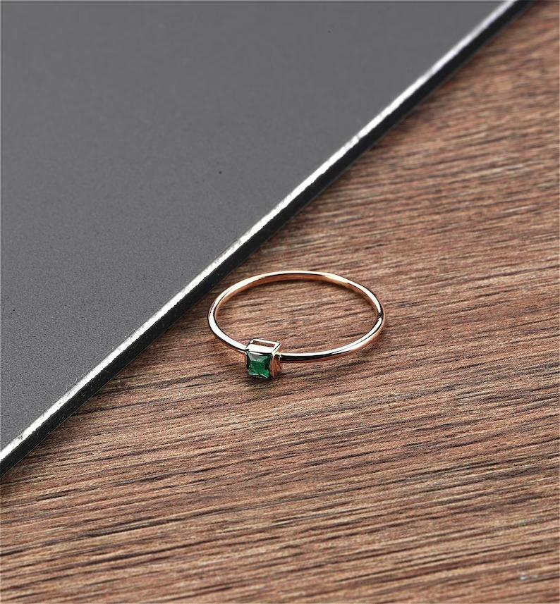 dainty princess cut emerald ring