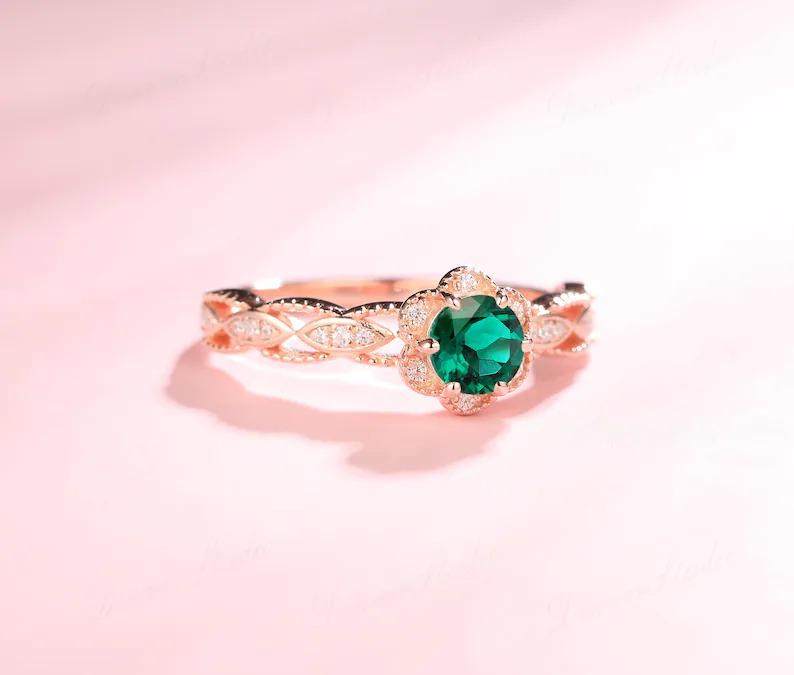 delicate floral vintage inspired rose gold emerald engagement ring
