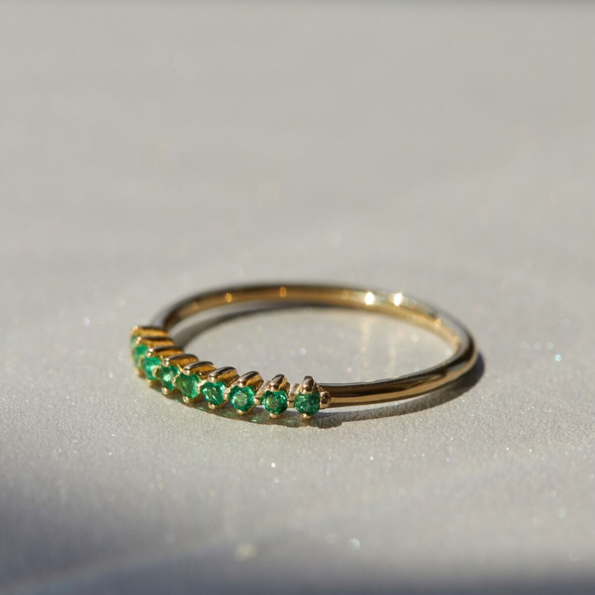 emerald dotted gold band