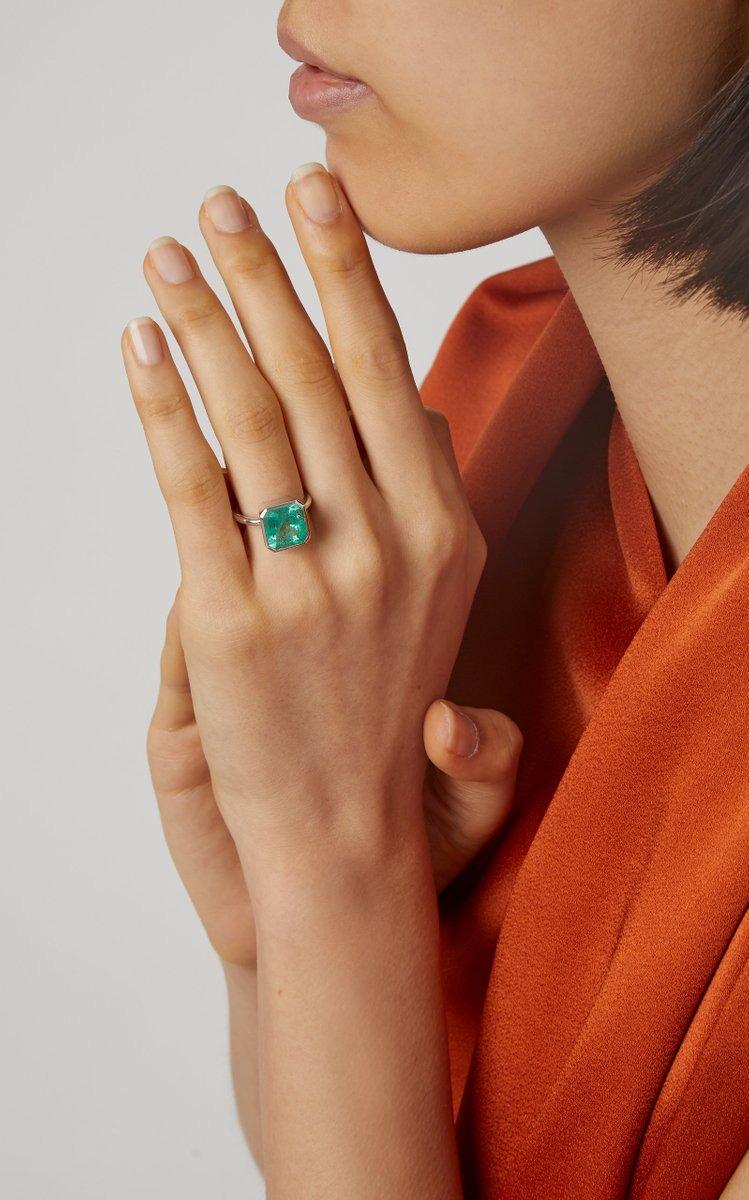 minimalist statement solitaire emerald engagement ring