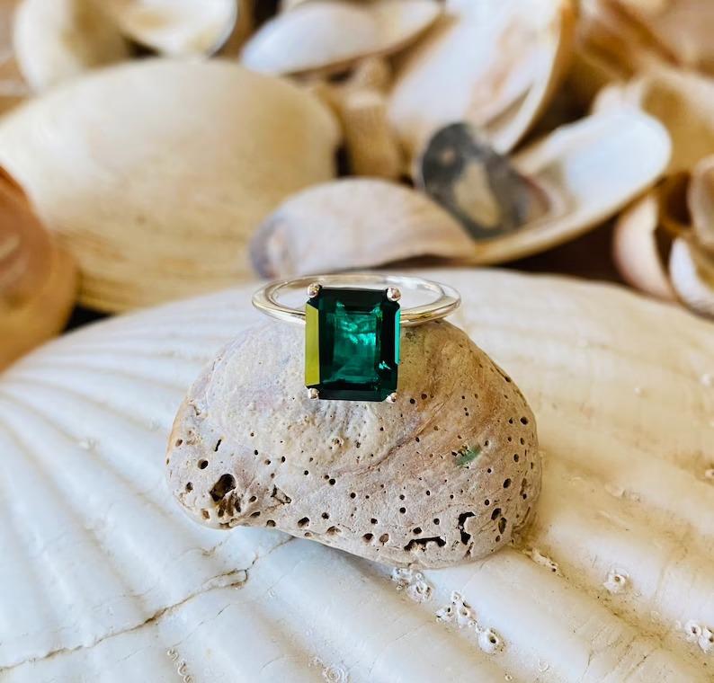 solitaire emerald cut emerald ring
