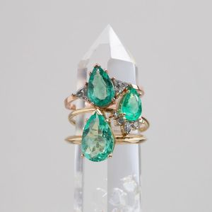 stack of emerald engagement rings by Alexis Russell