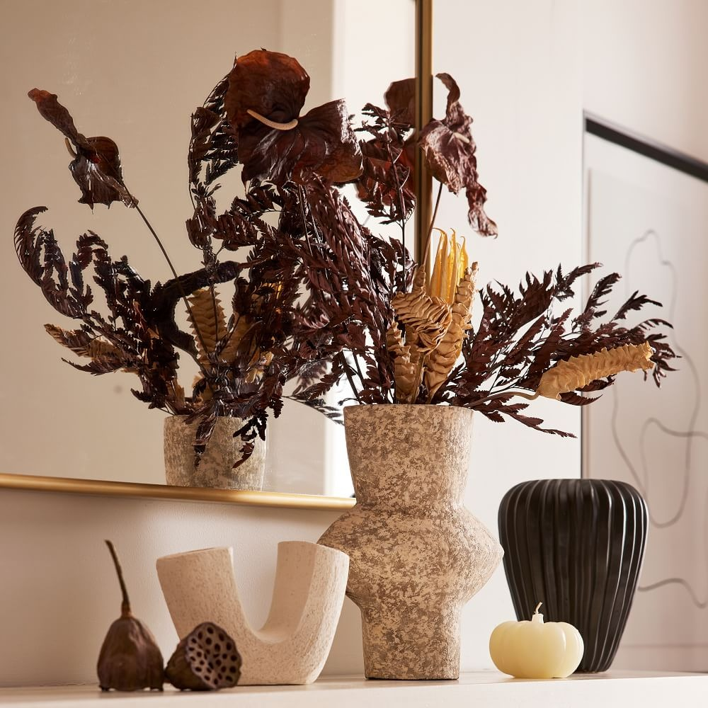 night harvest dried flower bouquet sitting in a spotted ceramic vase from West Elm