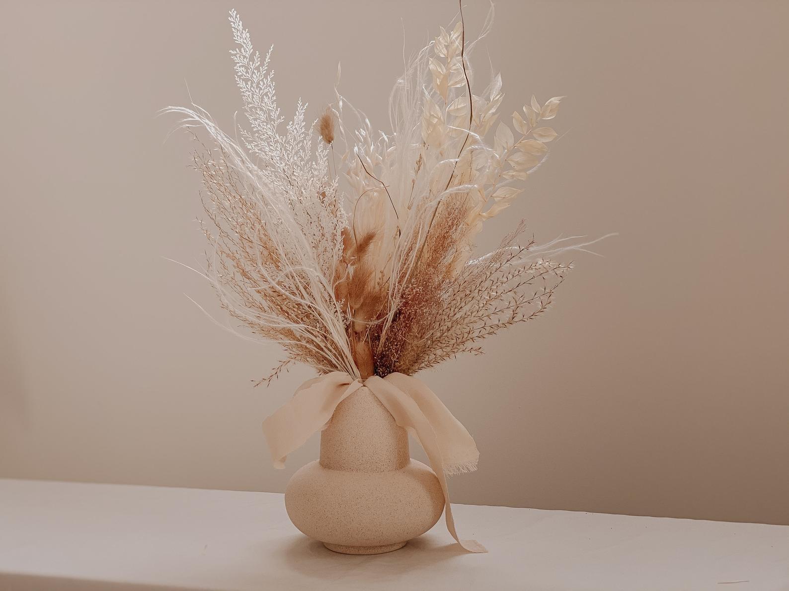 feathery blush neutral arrangement in a vase