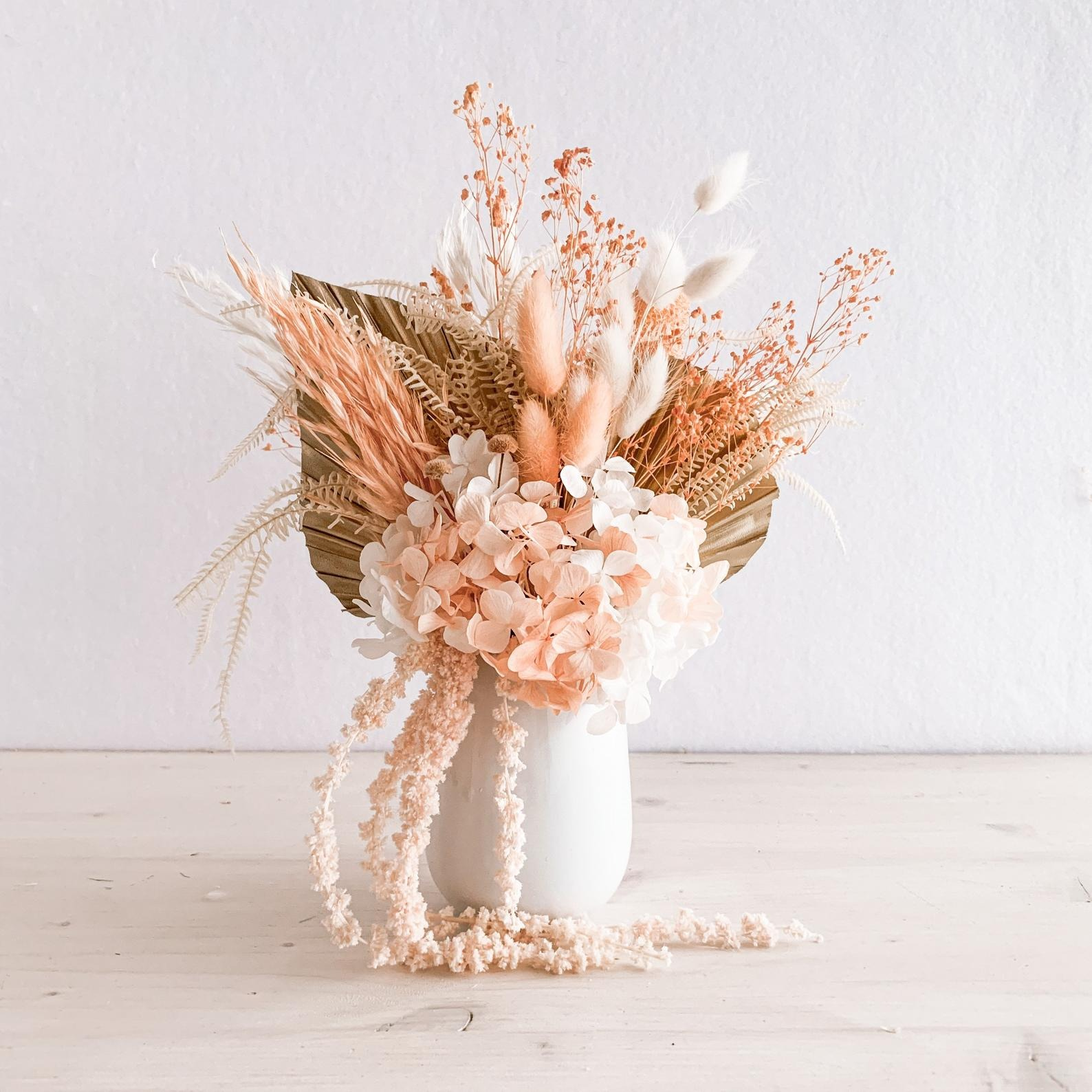 blush pink boho dried floral bouquet in a white vase from Etsy