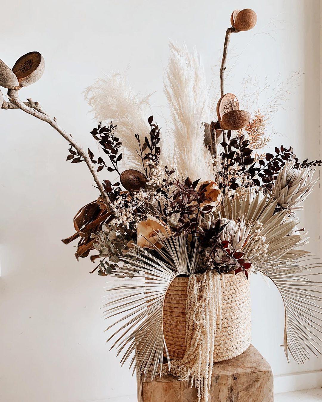 boho style dried flower arrangement sitting sitting in a vase
