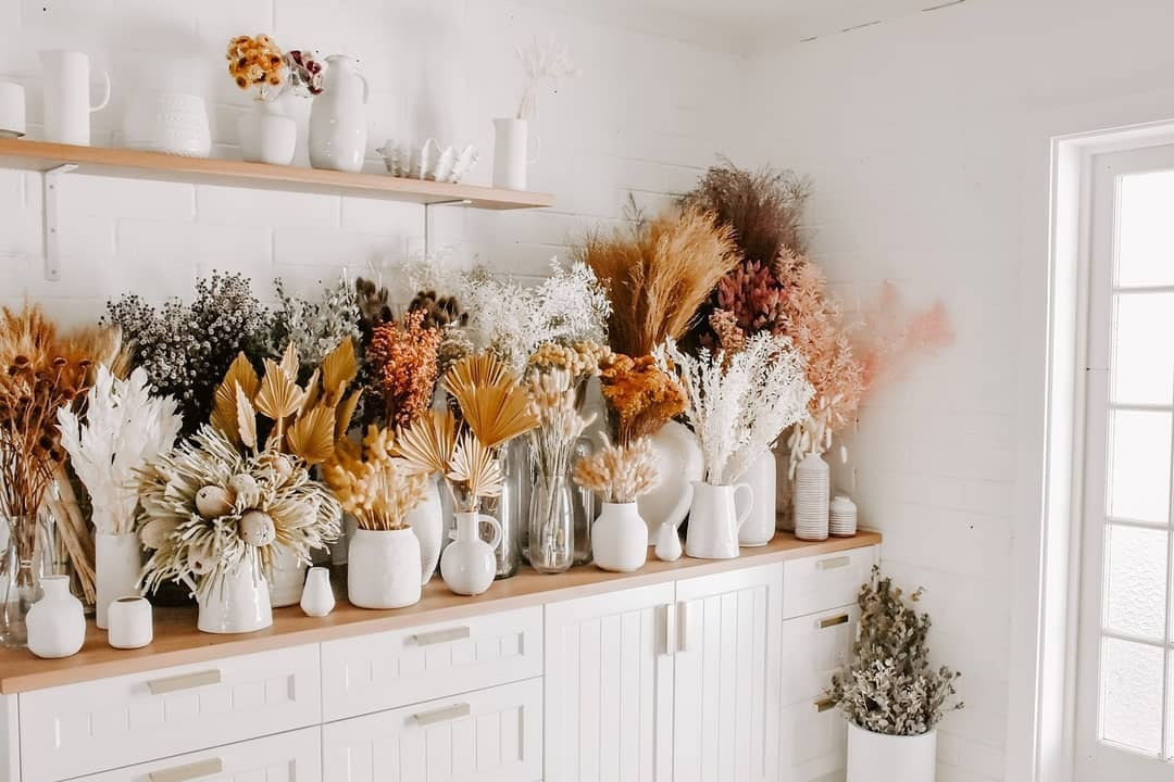 selection of dried flowers and dried flower bouquets placed in a collection on a shelf