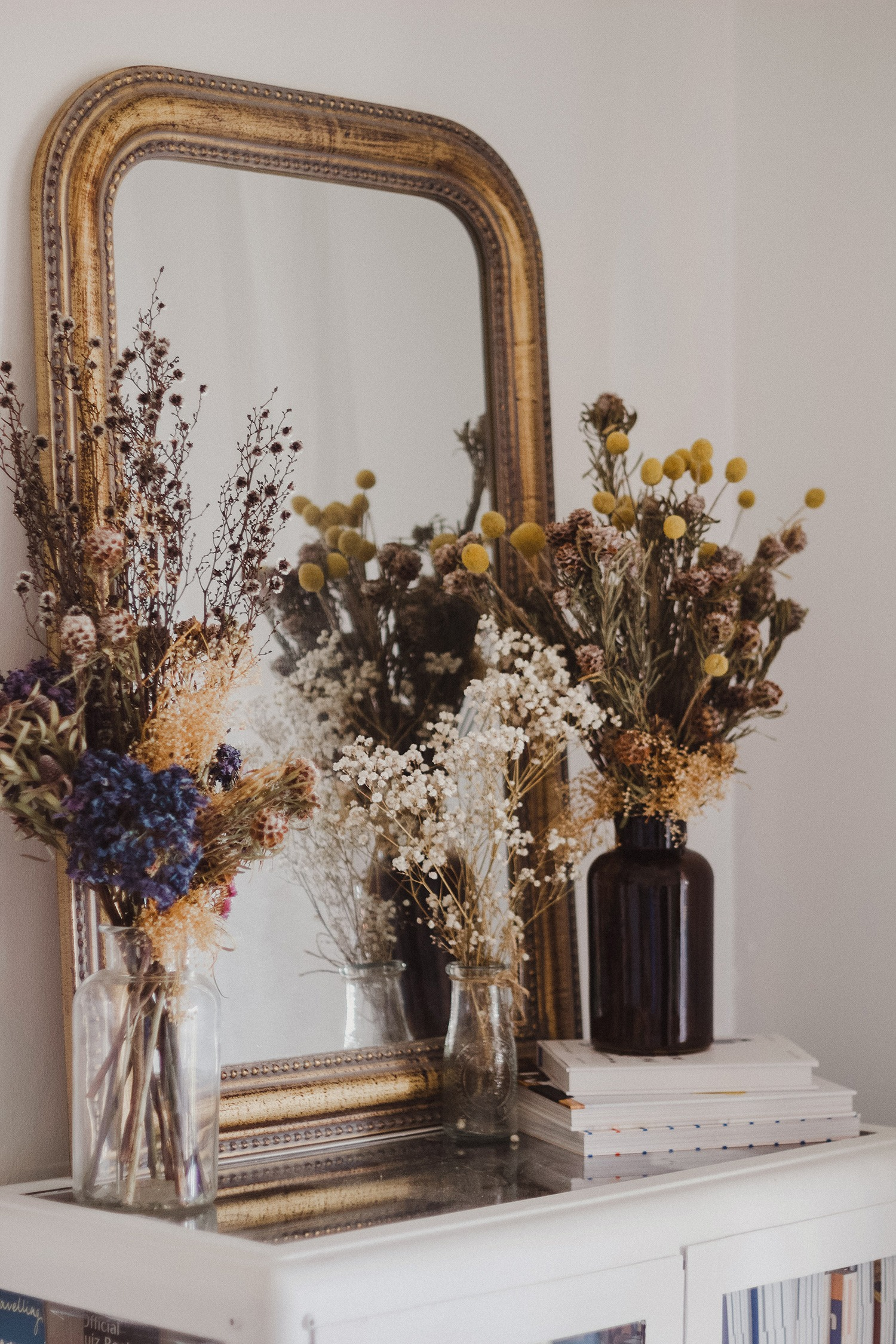 where to buy dried flowers online - bouquets of dried florals sitting in vases on a mantle
