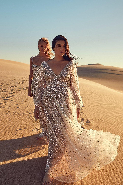 Chosen by Kyah curvy sparkling wedding dress with a deep v plunging neckline