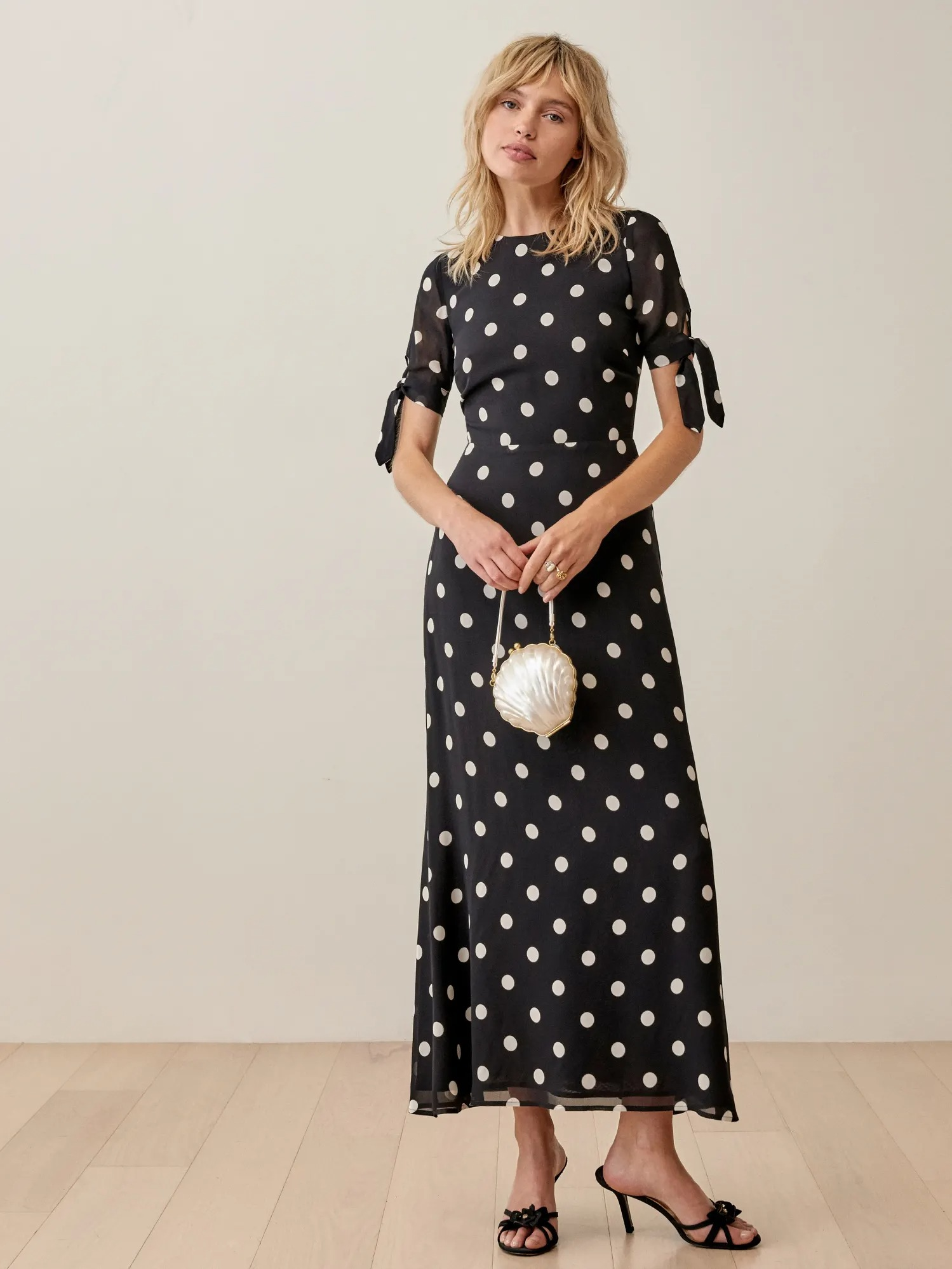 ankle length polka dot black and white wedding dresses with bow ties on the sleeves