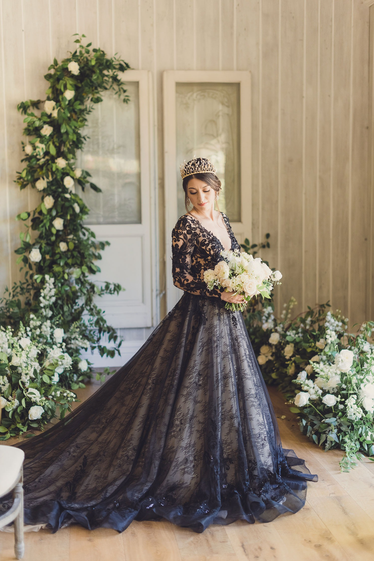 ballgown style black long sleeve wedding dress with lace bodice and train