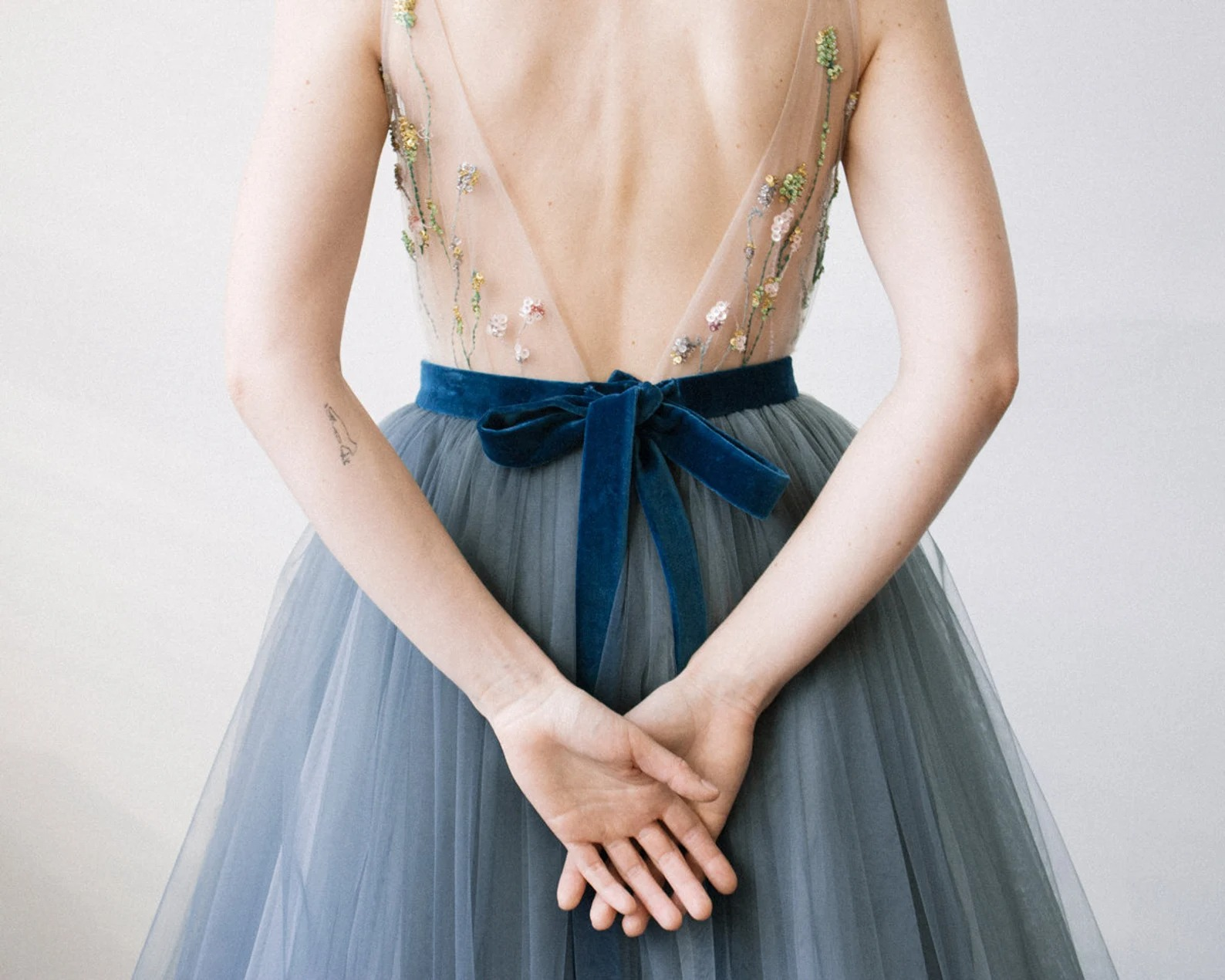 dusty blue tulle online wedding dress with a blue velvet ribbon around the waist