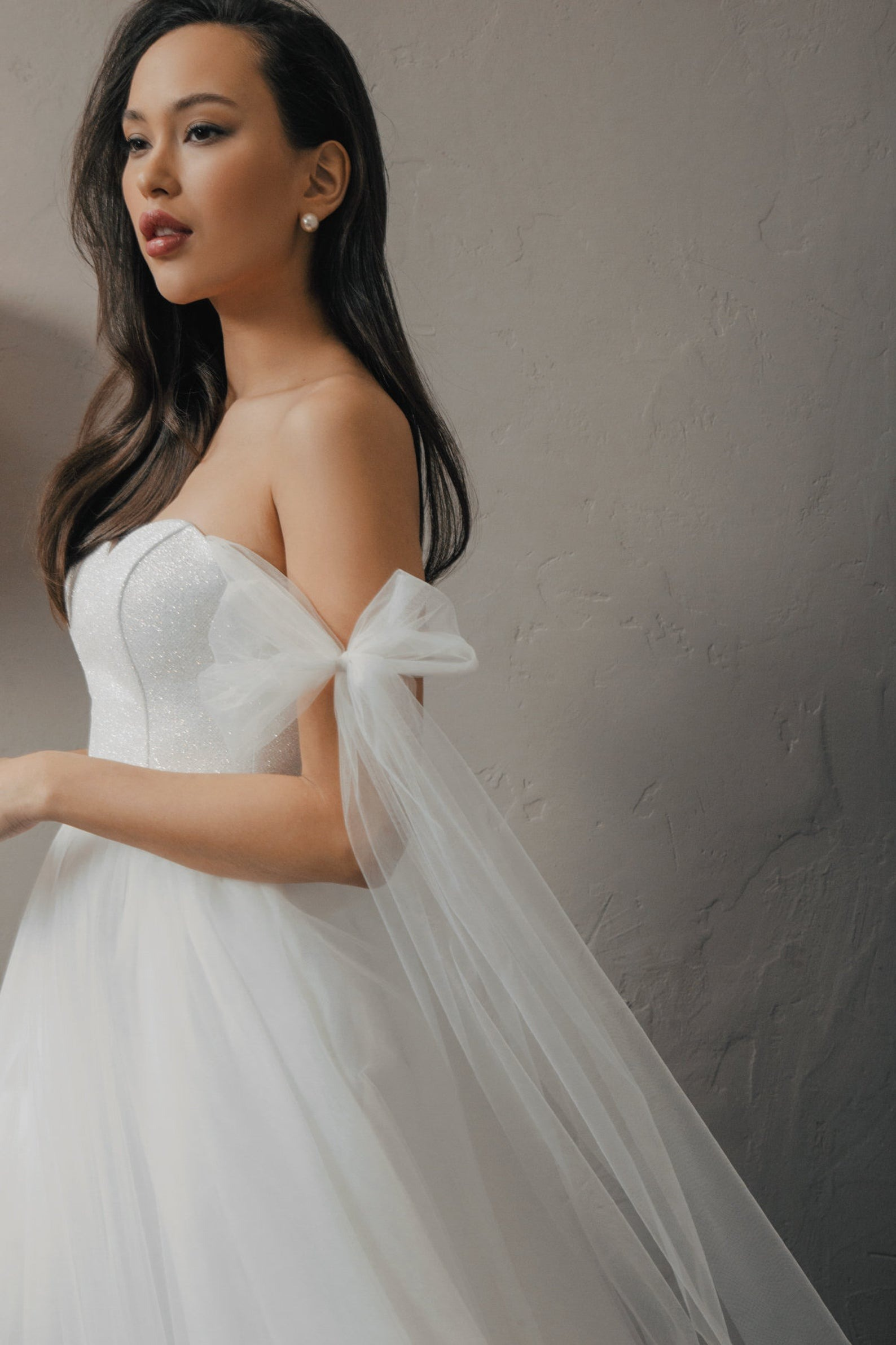 whimsical off shoulder online wedding dresses with tulle bowtie detailing from Piondress
