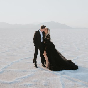 couple at the Utah salt flats with the bride wearing a black wedding dress