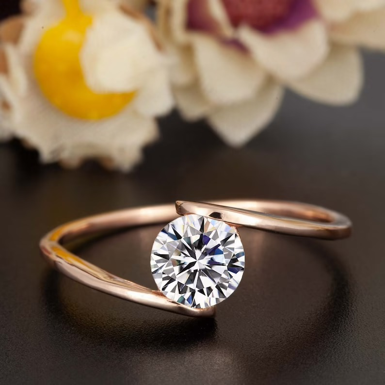 bypass style unique modern engagement ring with solitaire round moissanite center stone