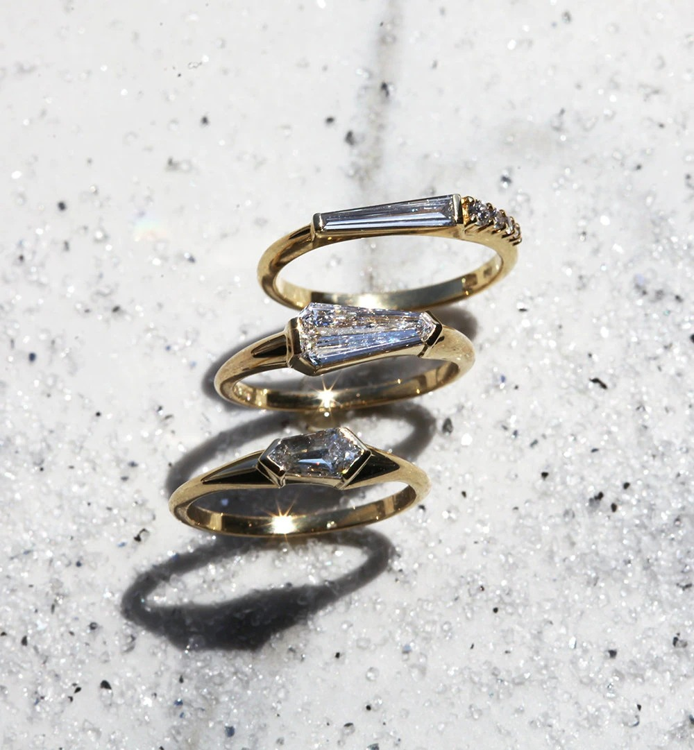 white and blue toned sparkle and brilliance of a collection of diamond rings vs moissanite