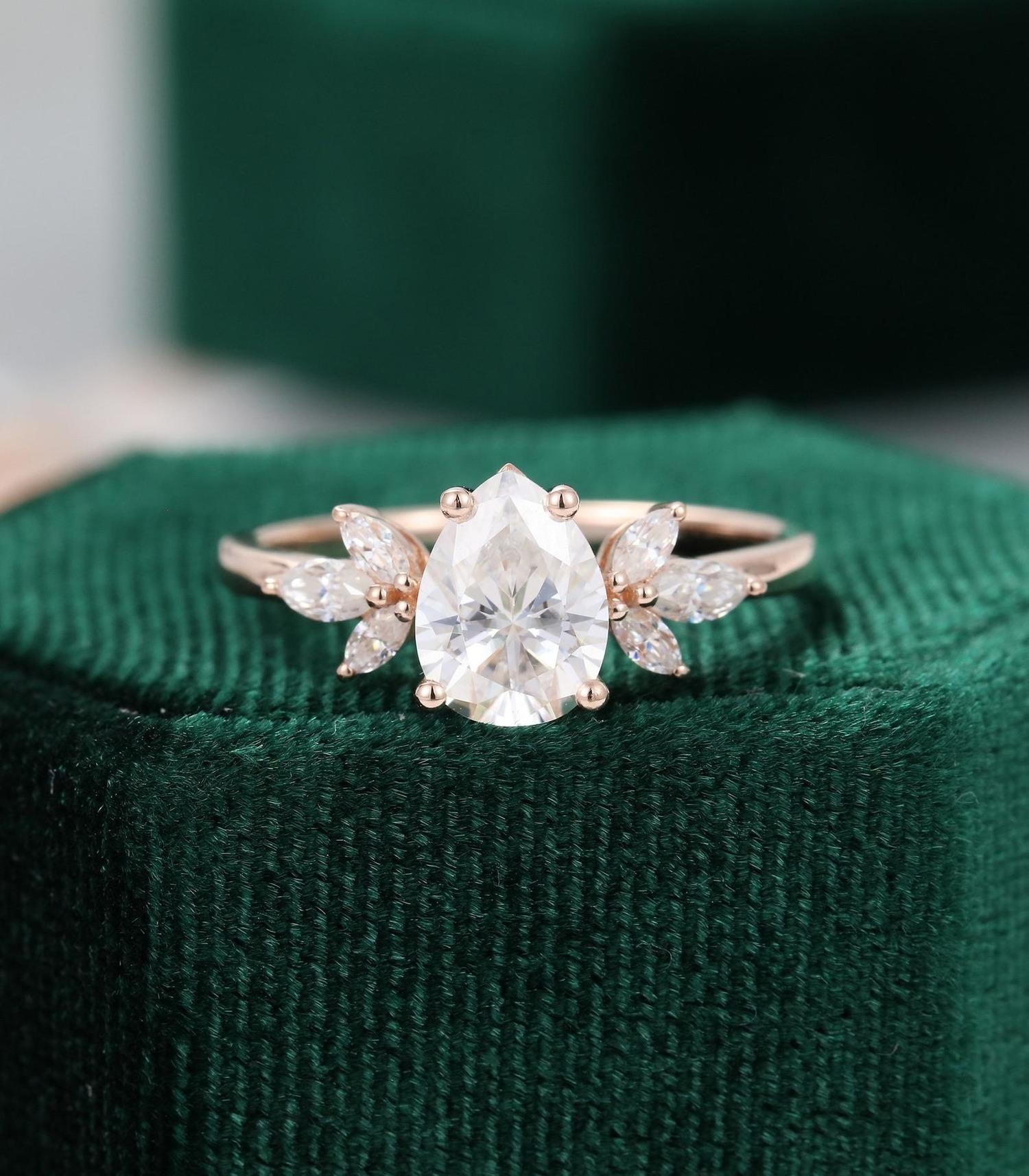 moissanite vs diamond delicate floral pear shaped band