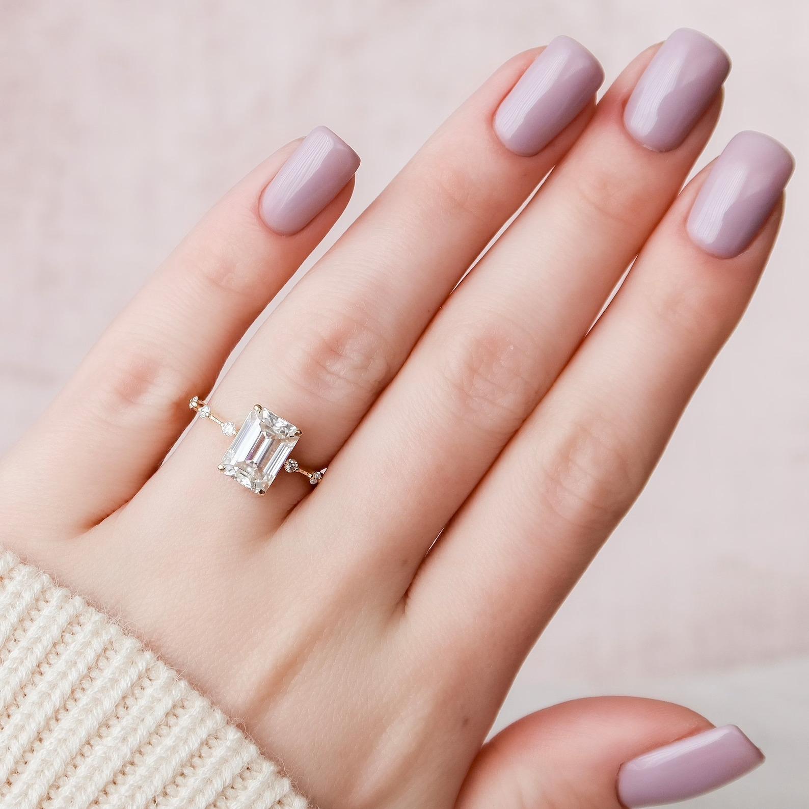 moissanite vs diamond minimalist emerald cut band