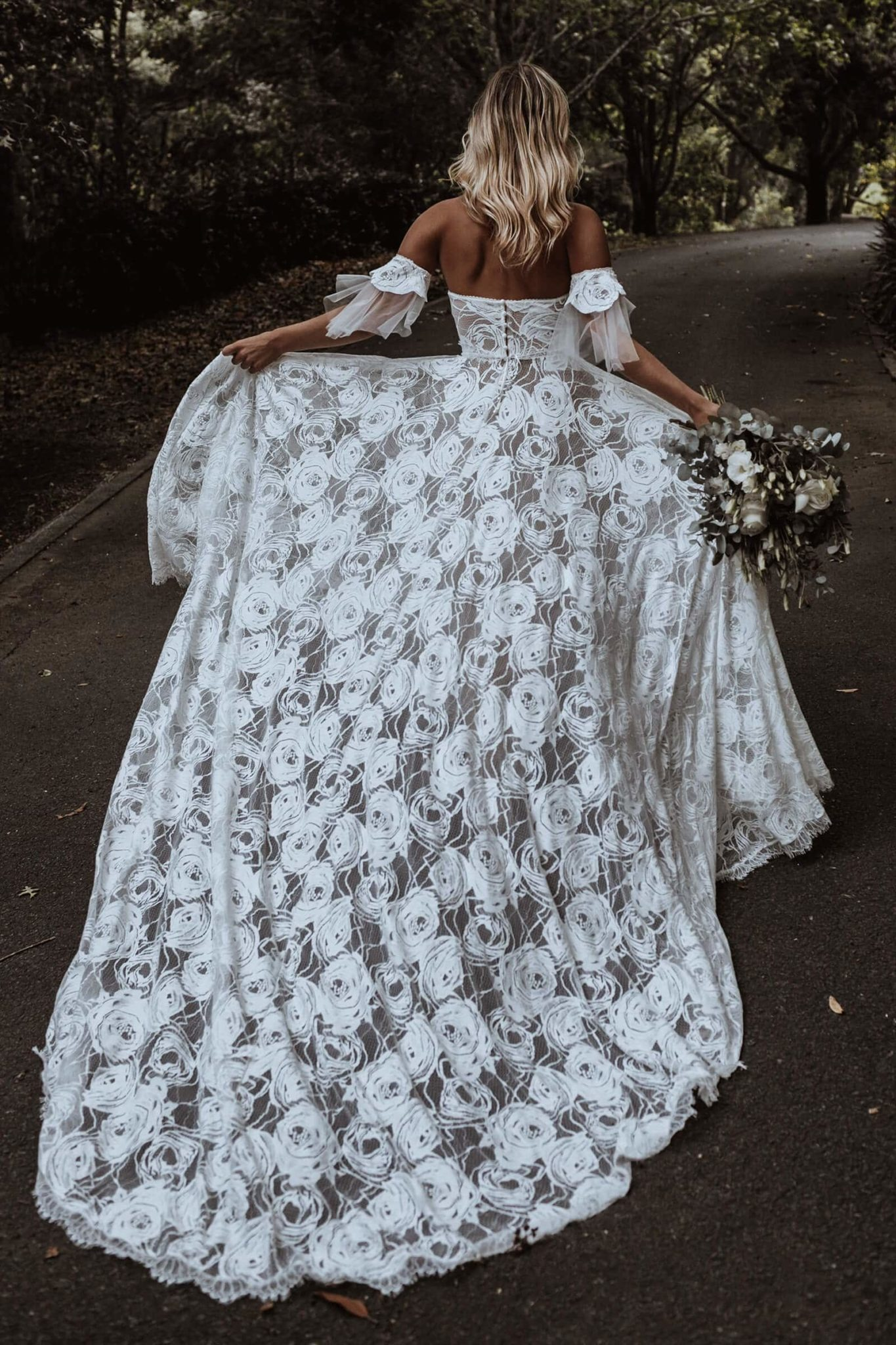 off shoulder corset style fitted bodice wedding dress with floral lace detailing