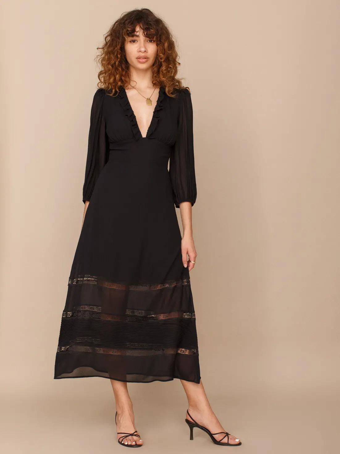 plunging neckline short black long sleeve wedding dress with sheer details