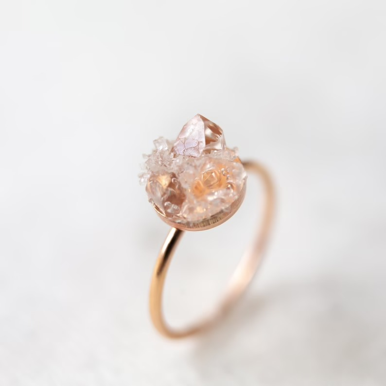 raw diamond engagement ring with a rose gold band