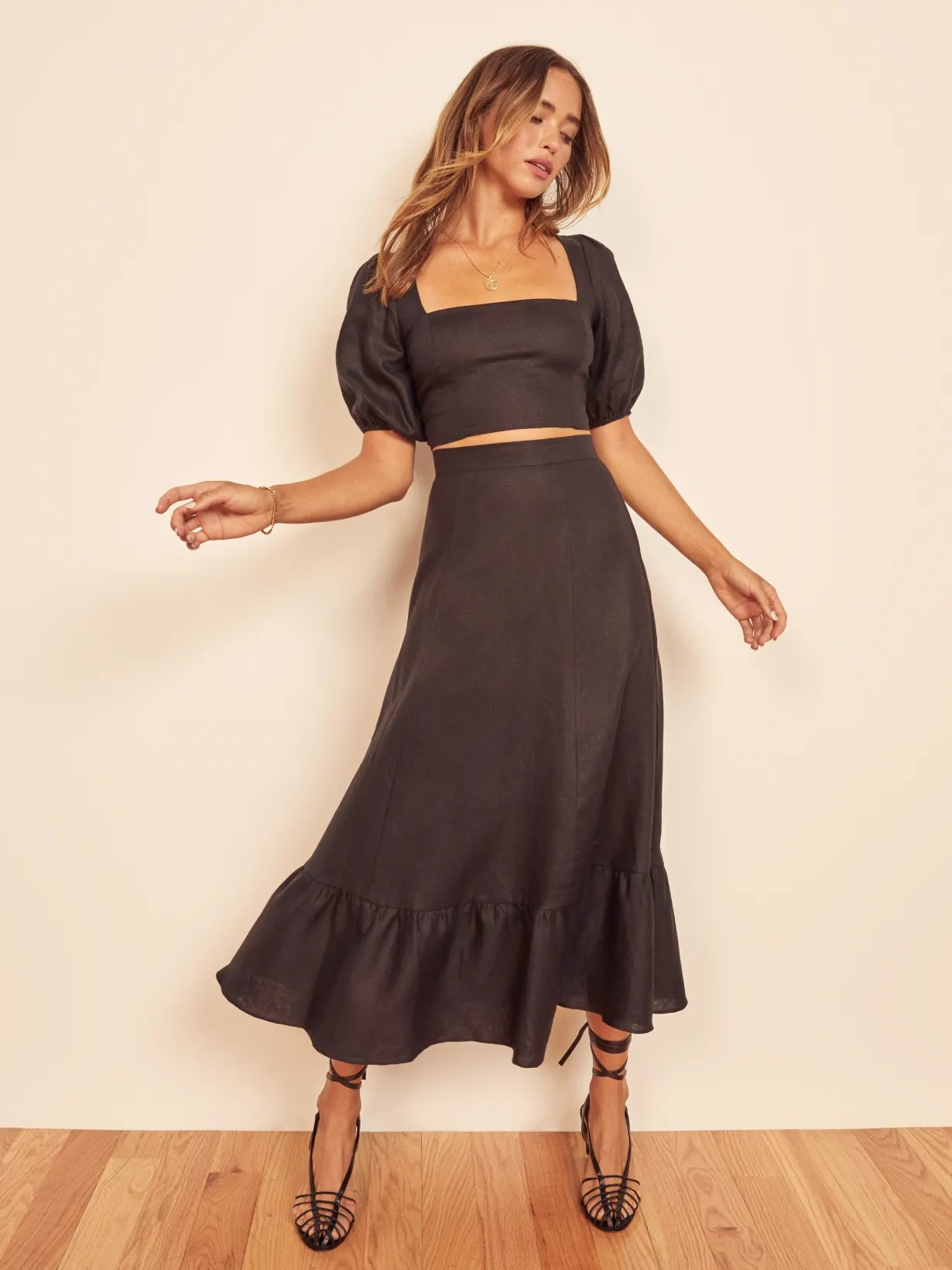 short two piece black top and skirt set for a wedding