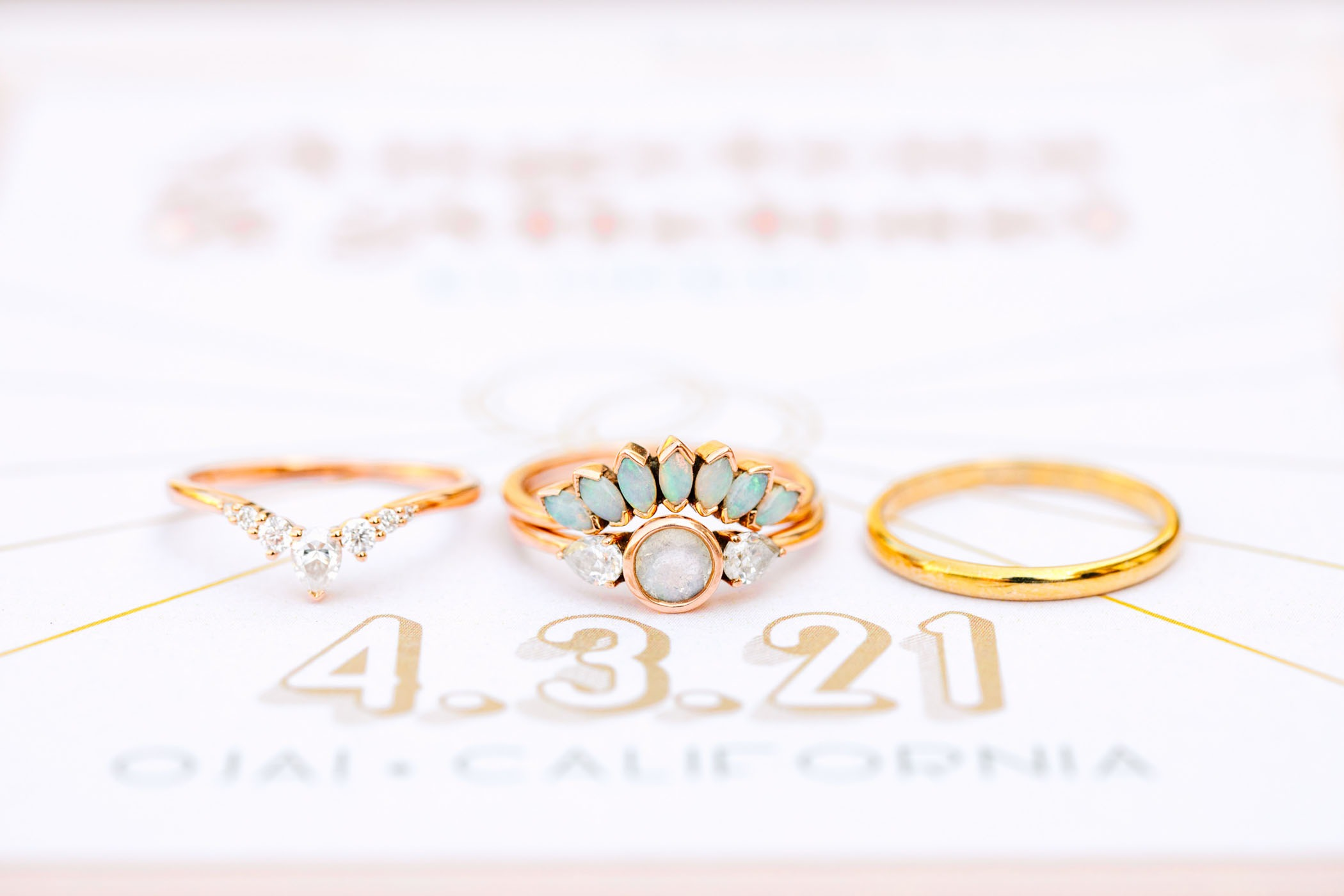bezel set engagement ring with opal accents