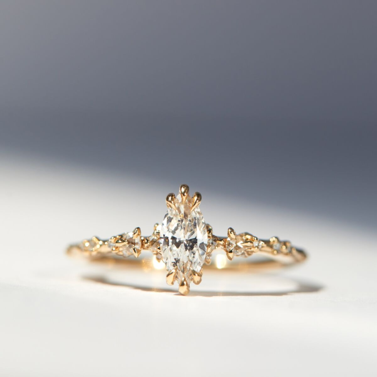 fairytale style gold marquise engagement ring