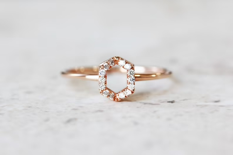 unique modern engagement ring with hollow hexagon center