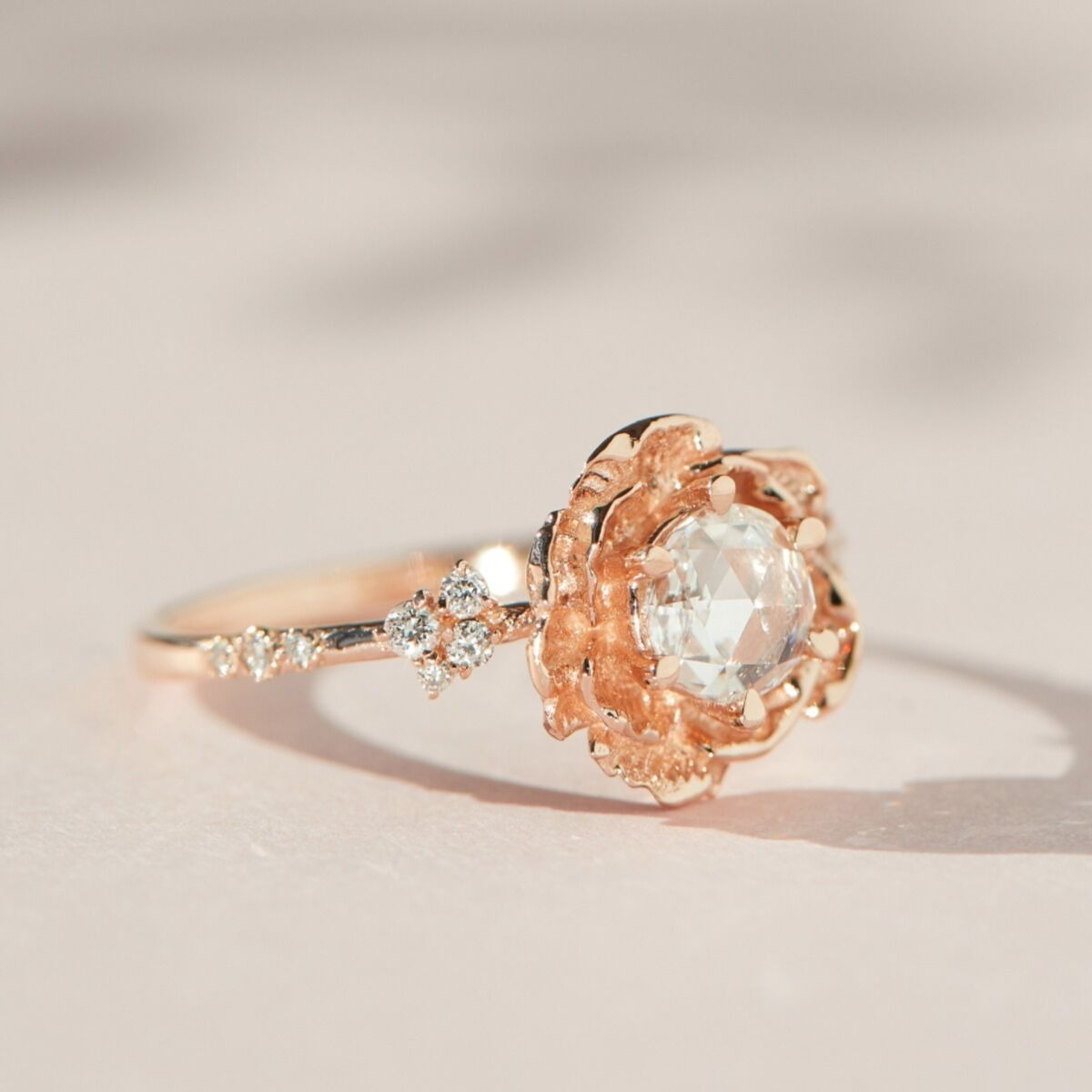 unique rose gold engagement rings with gold floral shape around diamond center stone