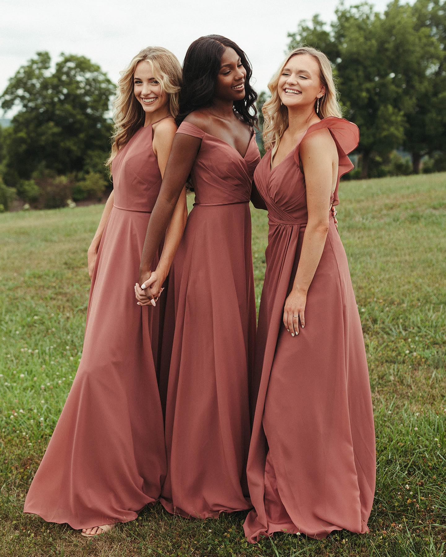 three girls in vow'd bridesmaid dress