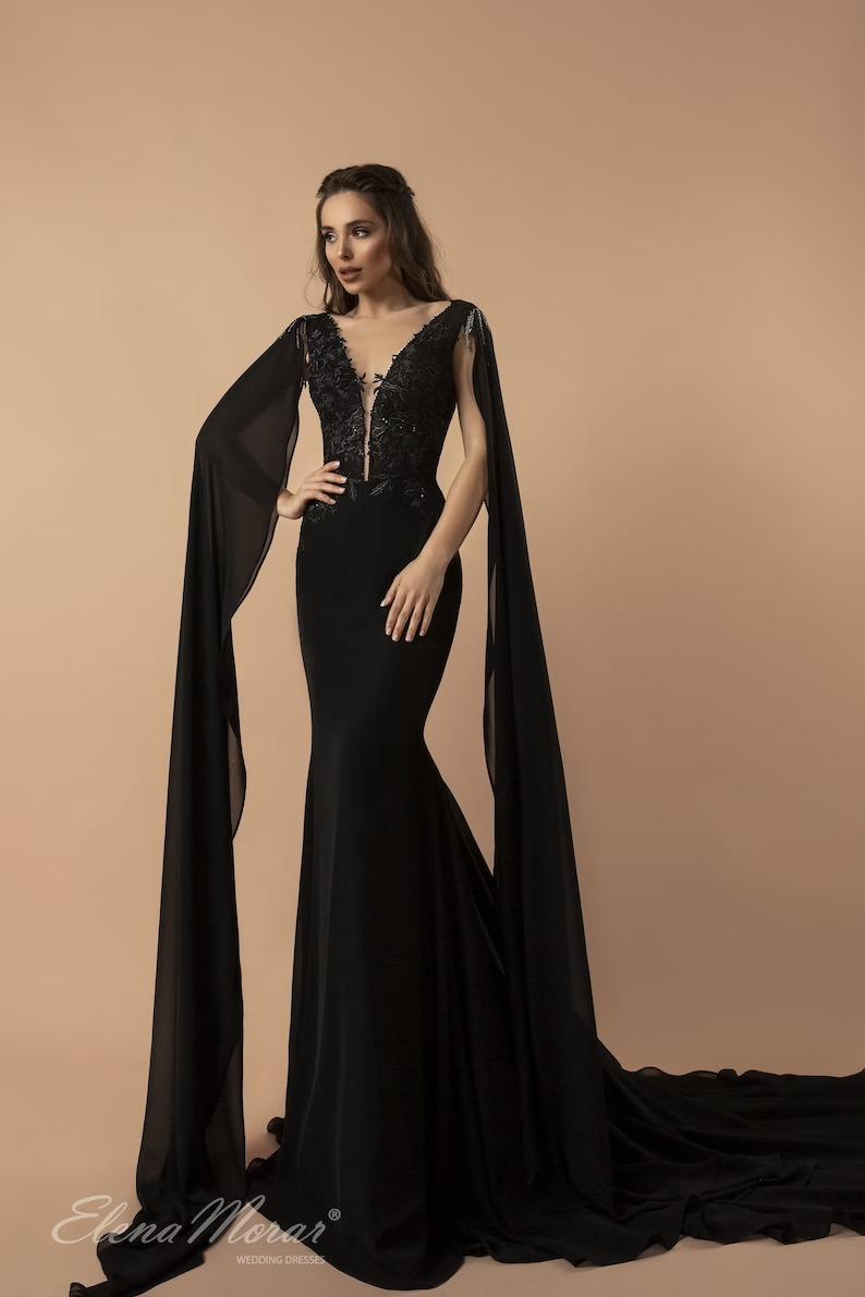 winged sleeve black mermaid wedding dress