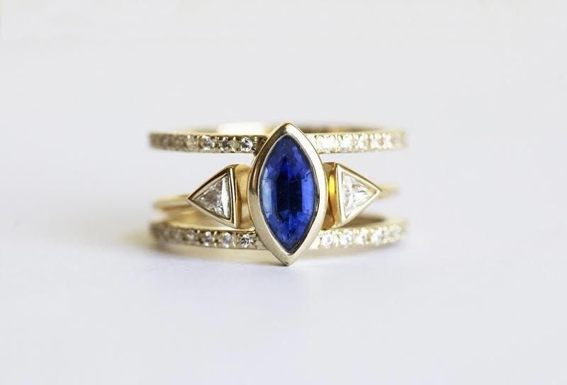 blue marquise sapphire engagement rings with double gold band