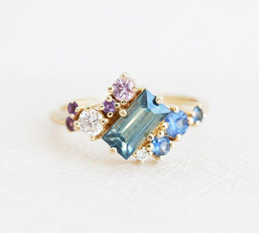cluster blue sapphire engagement ring with pink sapphires, amethyst, and diamond accents