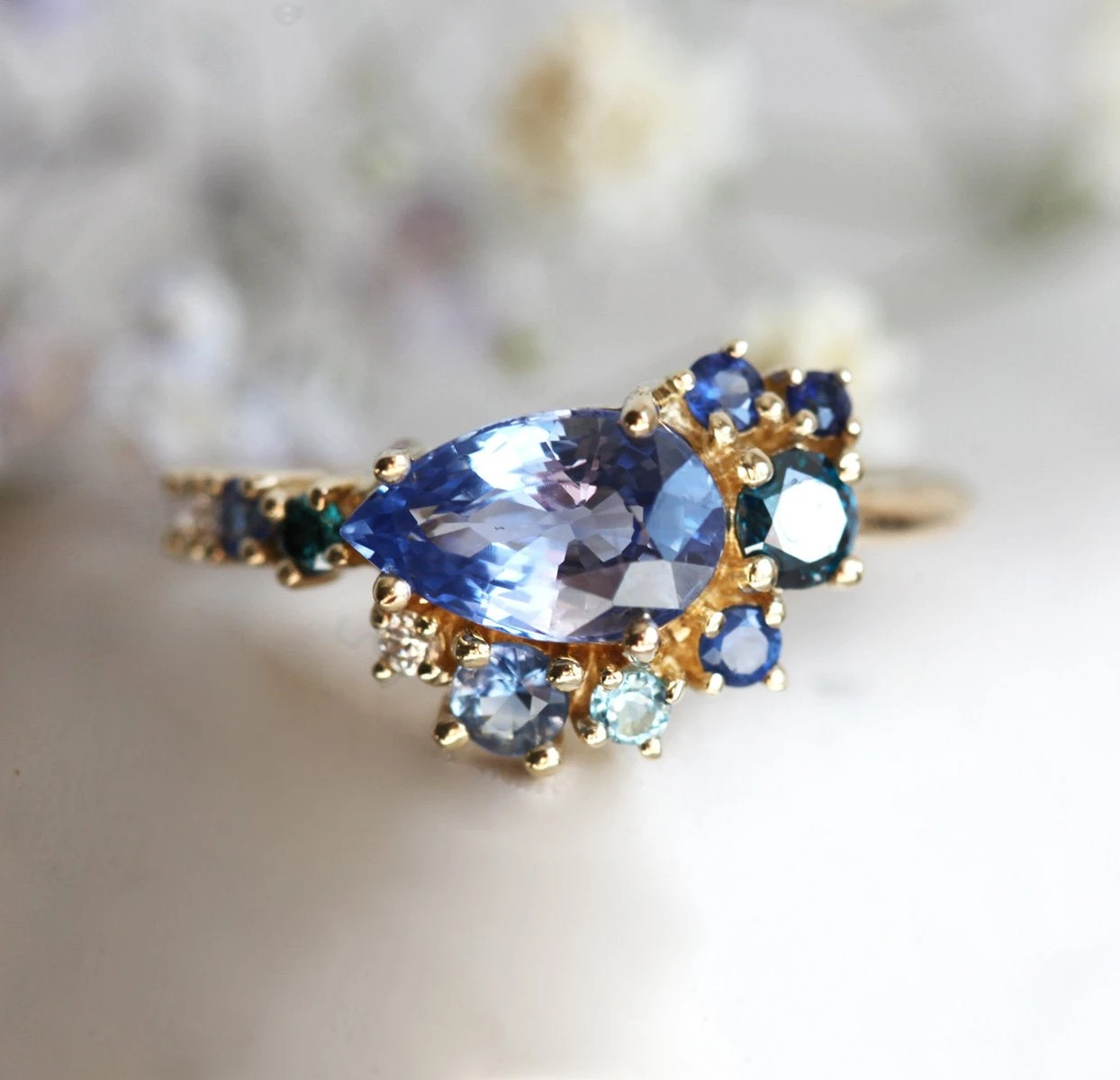 cluster pear shaped blue sapphire ring
