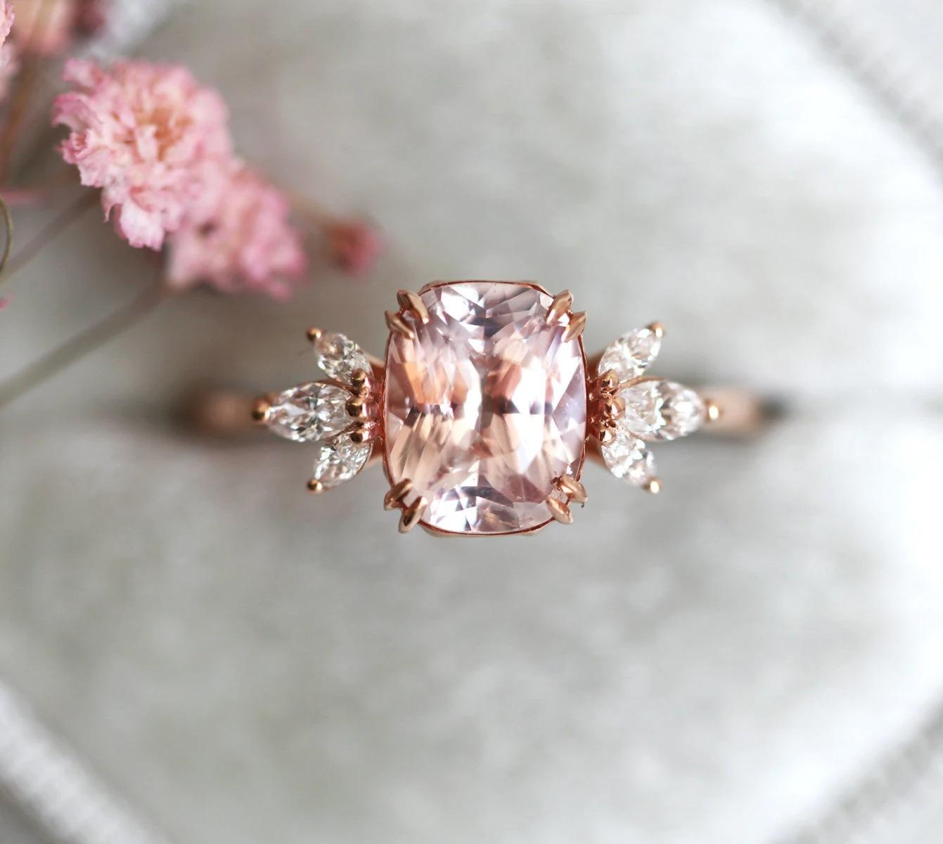 cushion cut peach sapphire ring with marquise diamond accents