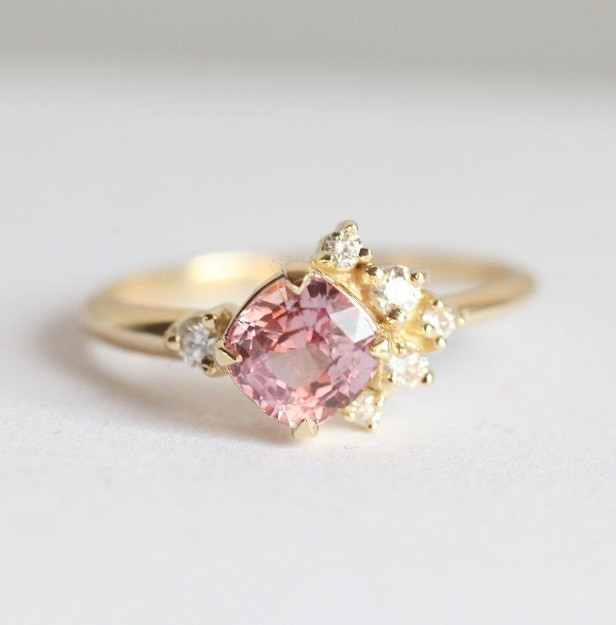 cushion cut pink sapphire ring with asymmetrical diamond cluster