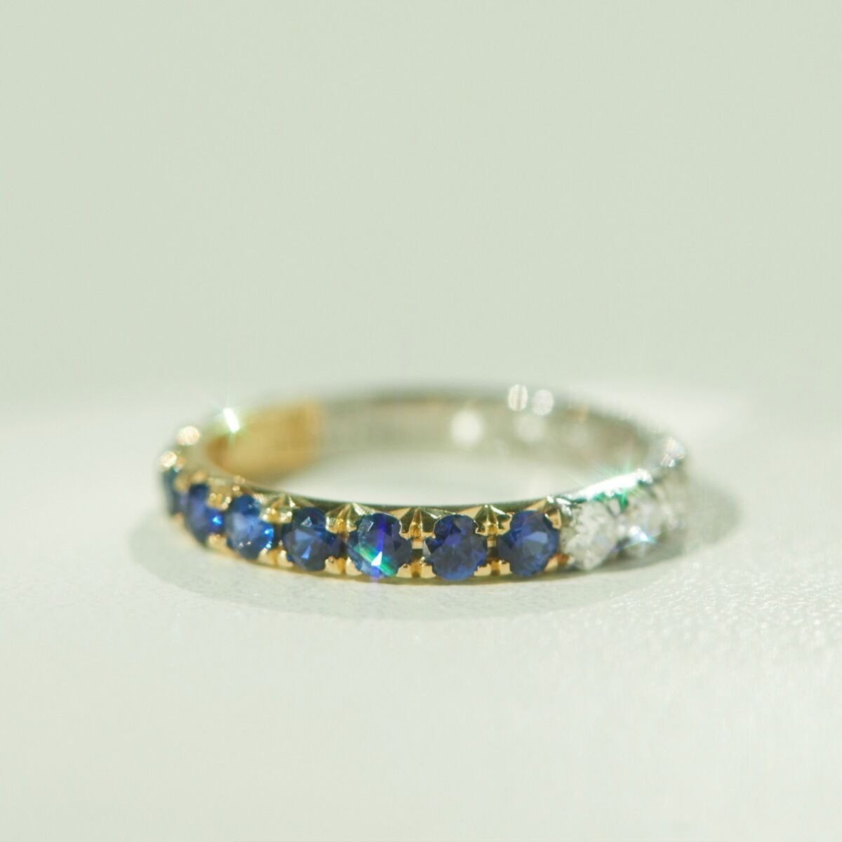 diamond and blue sapphire band with dual color yellow gold and platinum band