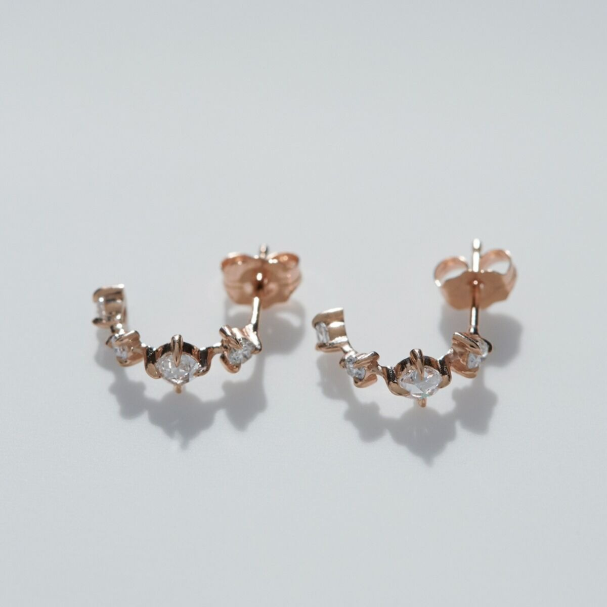 diamond studded rose gold hoop wedding earrings