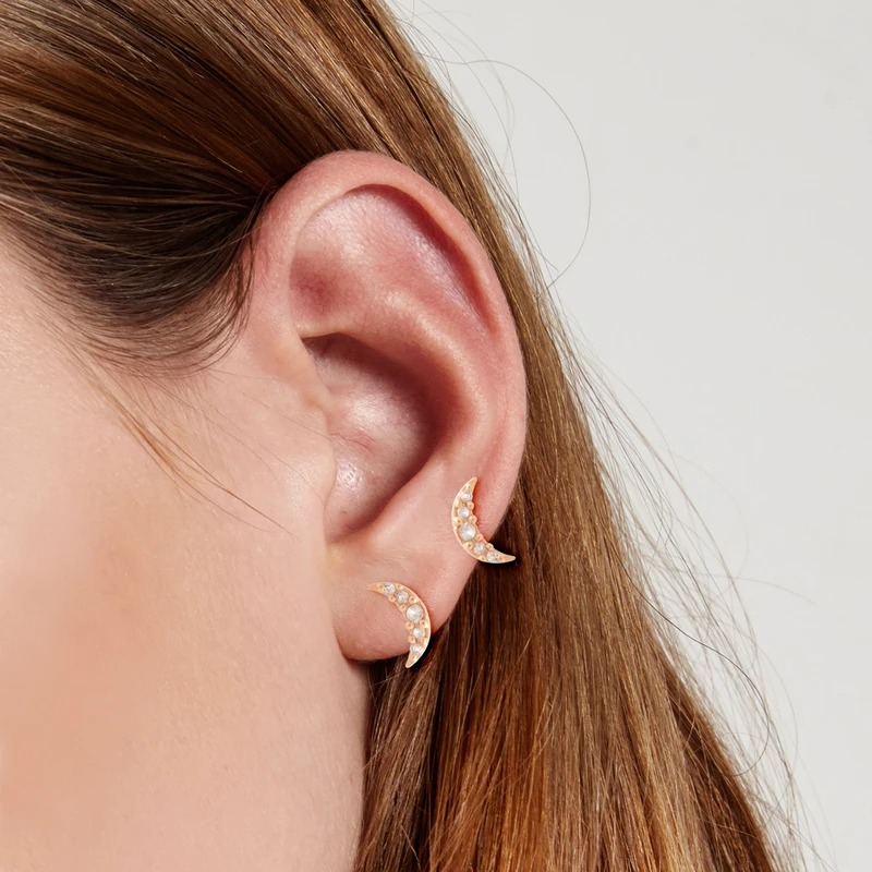 gold and diamond crescent moon stud earrings