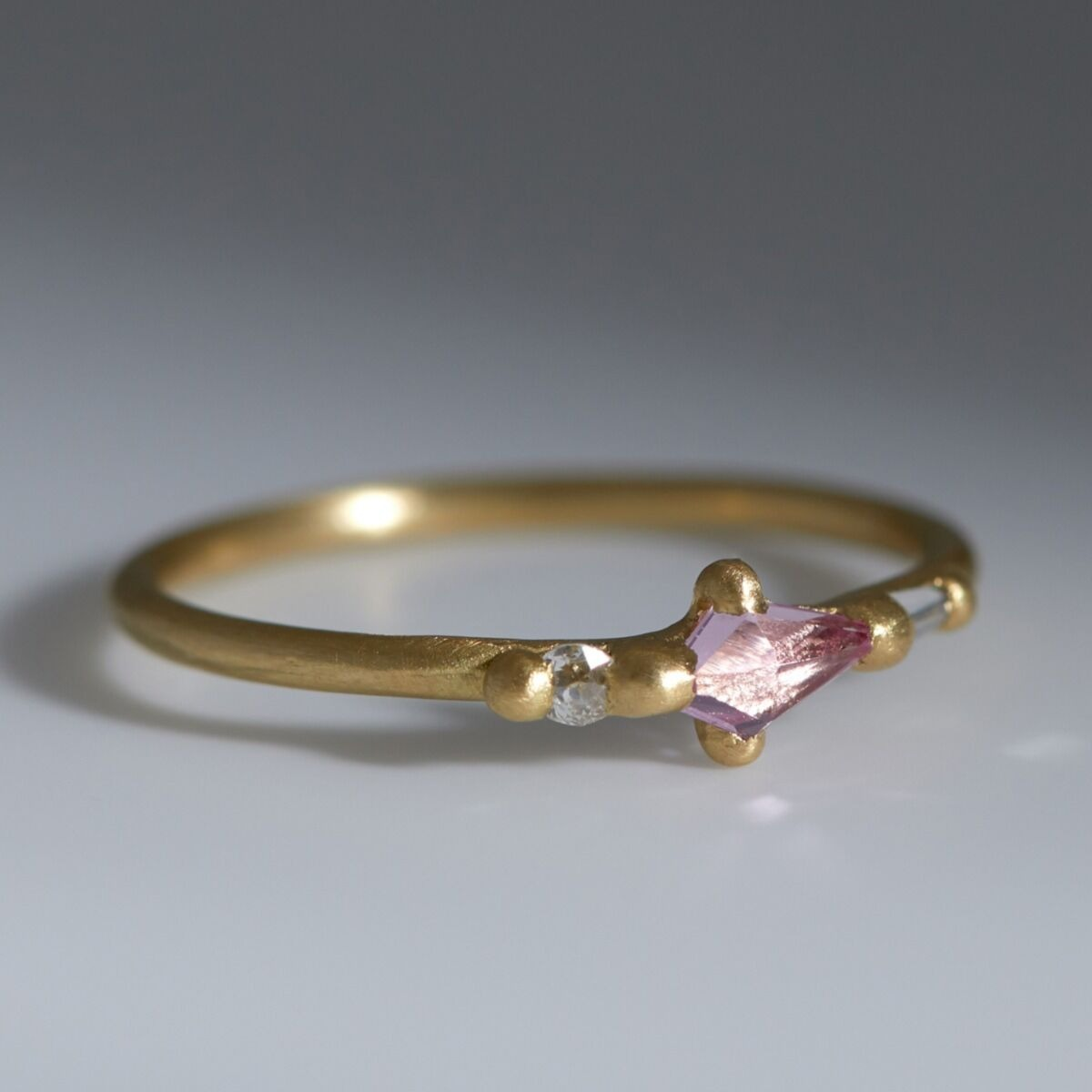 kite cut pink sapphire band