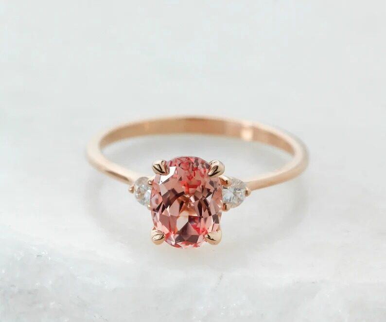 lab created oval pinky peach sapphire