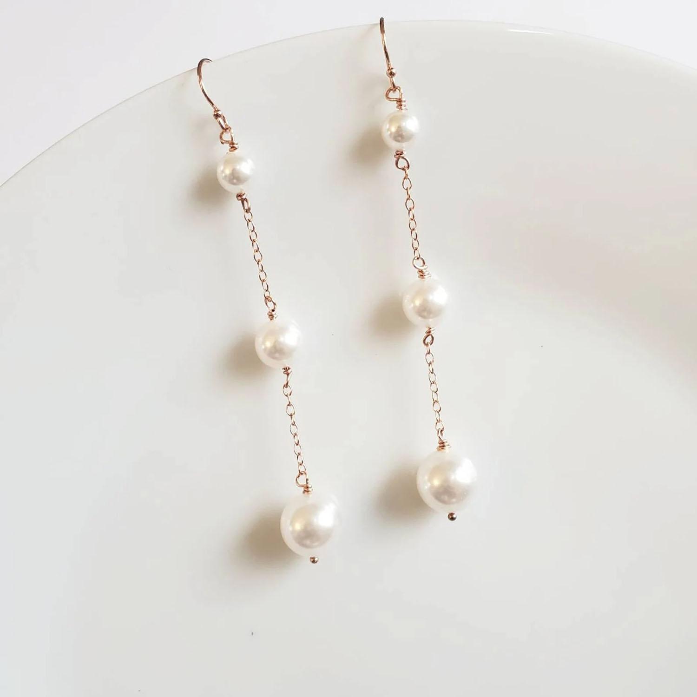 long gold pearl trio earrings