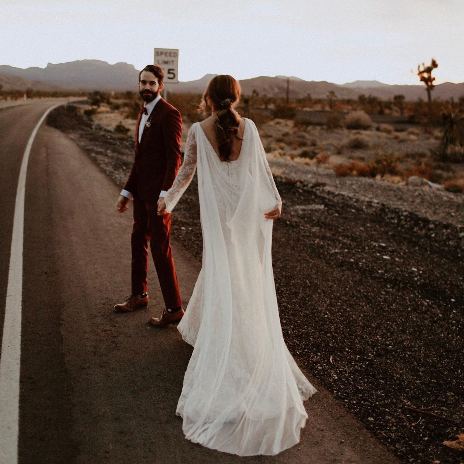 long wedding cape silk bride and groom in street