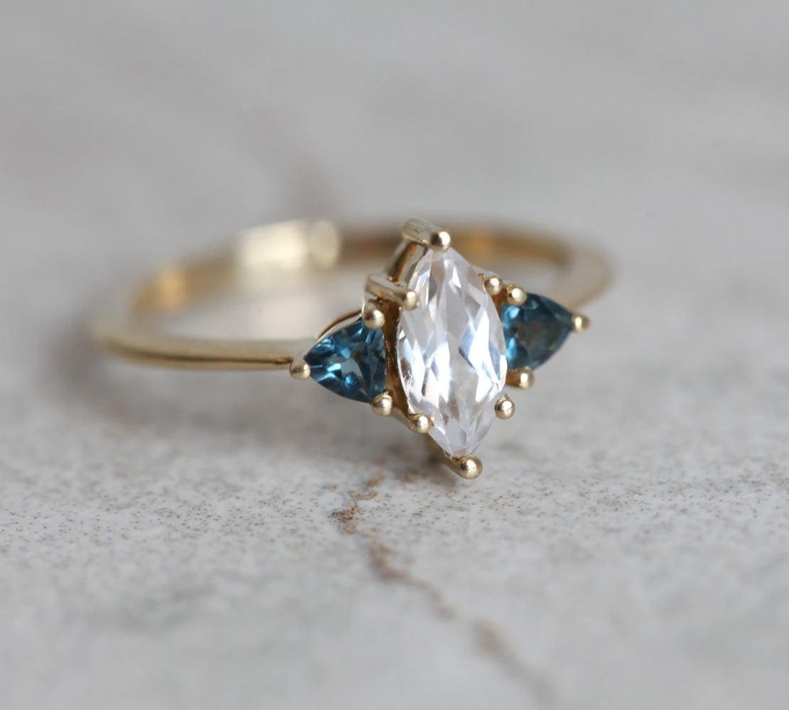 marquise white sapphire yellow gold band with London blue topaz triangle accent stones