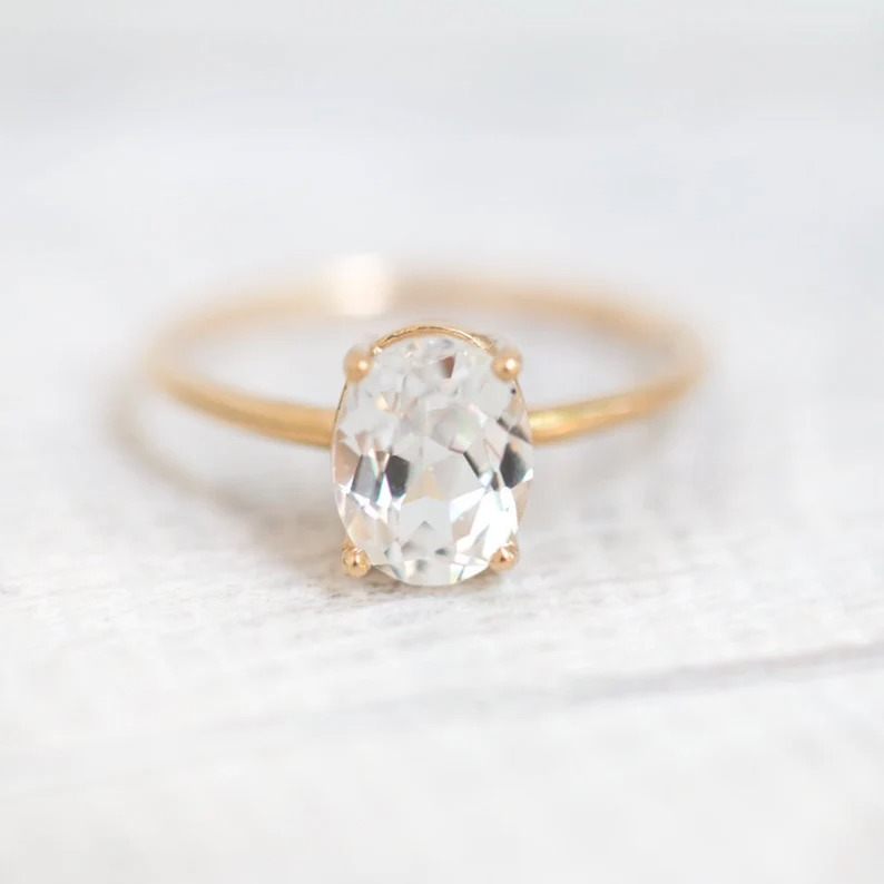 minimalist modern oval white sapphire solitaire band