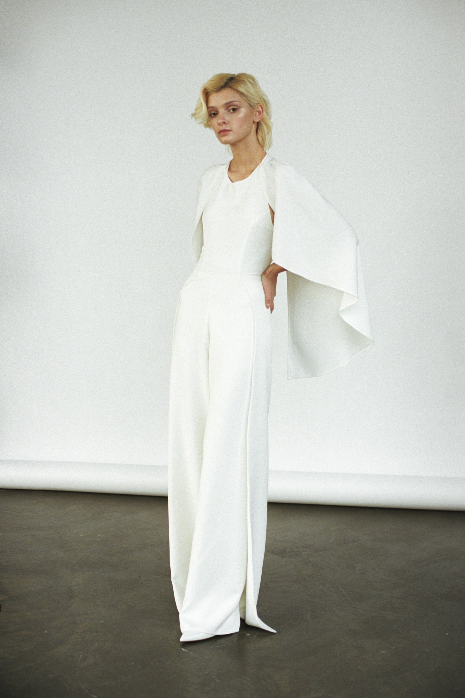 modern wedding gown with cape jumpsuit