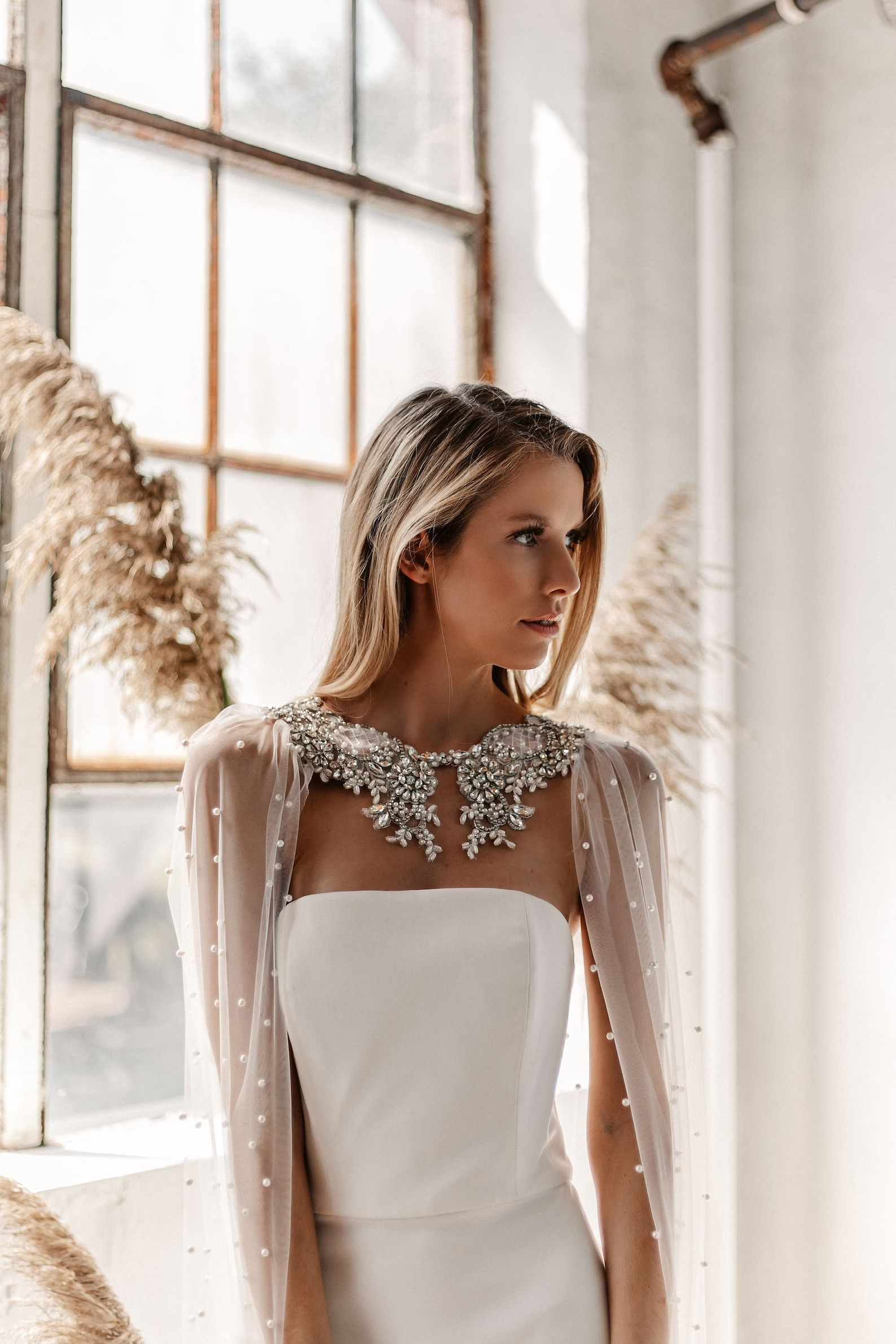 pearl embellished cape with jewel necklacejpg