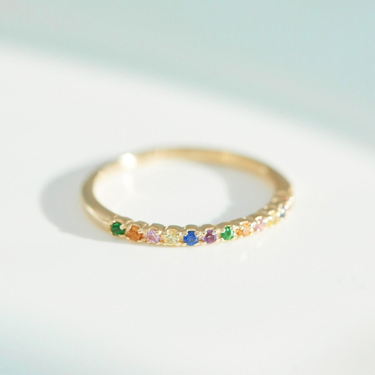 rainbow sapphire engagement ring with yellow gold band